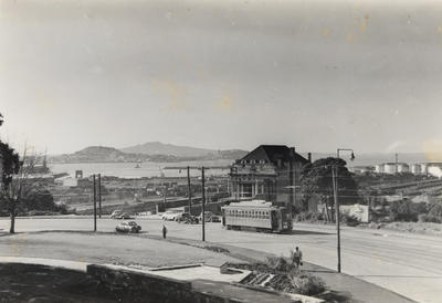 [Tram on Anzac Avenue showing a view of the Waitemata Harbour out to Devonport and Rangitoto Island]