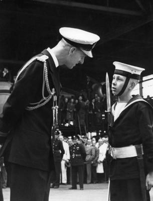Photograph of Prince Philip talks to a Navy cadet