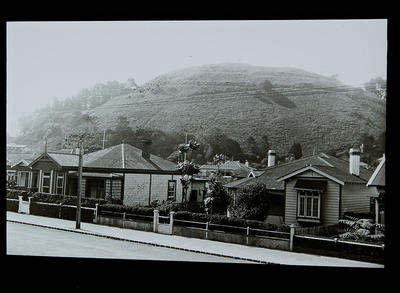 [Auckland mountain with houses at bottom]