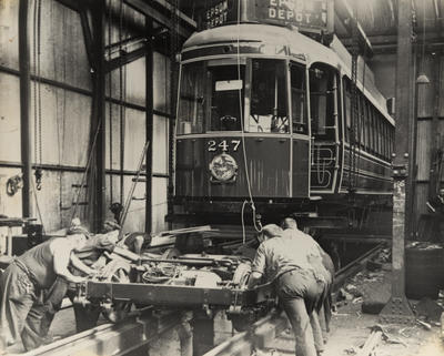 [Bogies being fitted to tram no. 247 the first Auckland streamliner with curved sides]