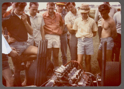 [Crowd looking at engine]