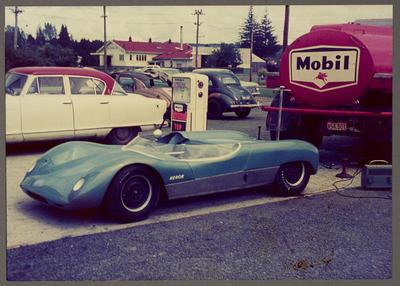 [Heron MK1 Sports Racing Car at petrol station]
