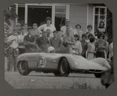 [Heron MK1 Sports Racing car in race with crowd]