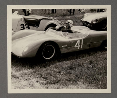 [Heron MK1 Sports Racing car parked with driver in racing gear]