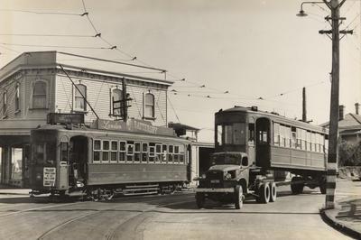 [Active tram no. 218 and retired tram no. 224 on the corner of Manukau Road and Trafalgar Street]; Graham Stewart; 1956