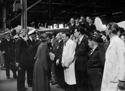 Photograph of Princess Elizabeth and Prince Philip talking to a group of Short staff in a hangar