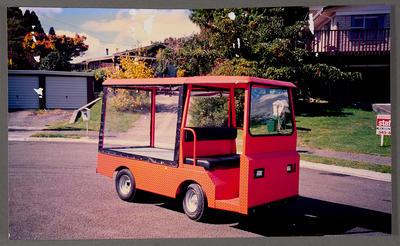[Orange buggy parked on road]
