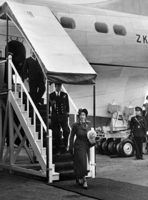 Photograph of Princess Elizabeth and Prince Philip walking off a flying boat at Short Brothers Limited