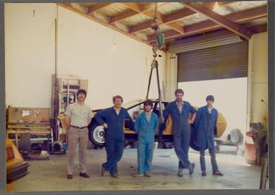 [Heron Developments staff in front of Heron MJ1 fibreglass body in Heron Developments workshop]