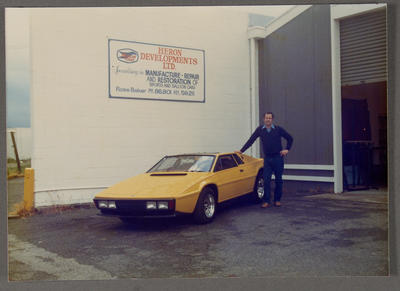 [Heron MJ1 yellow in front of Heron Developments with unidentified person]; Ross Baker; Unknown; 1962-1999