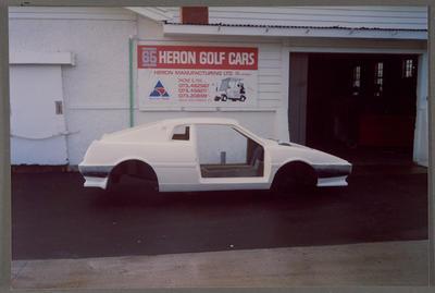 [Heron MJ1 fibreglass body next to Heron Golf Cars sign]