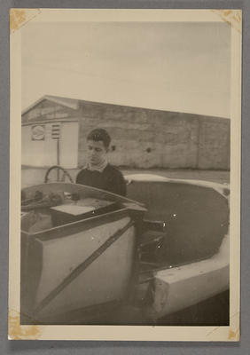 [Unidentified person in drivers seat of automobile]