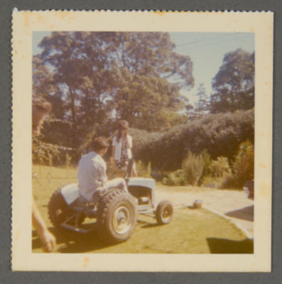 [Unidentified person on lawnmower]