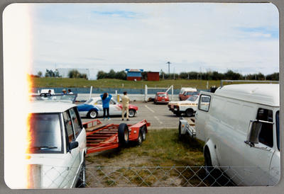 [Automobiles at race track]