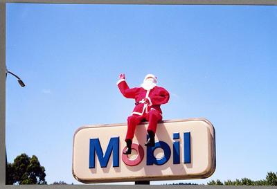 [Santa mannequin on a Mobil sign]