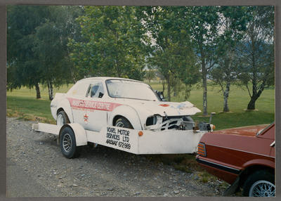 [Vogel Motor Services Ltd automobile on trailer]; Ross Baker; 1950s-1990s