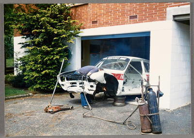 [Repairs on crashed Ford Escort automobile]; Ross Baker; 1950s-1990s
