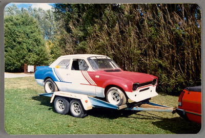 [Ford Escort racing automobile on a trailer]
