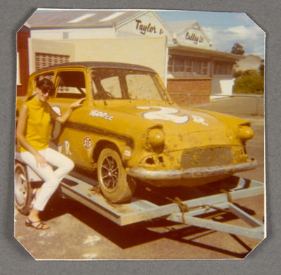 [Ford Anglia Saloon Car on trailer with unidentified person]