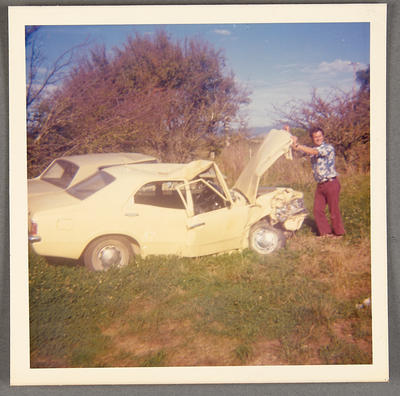 [Wreck of MK3 Cortina Saloon Car with unidentified person]