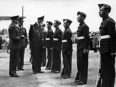 Photograph of Princess Elizabeth and Prince Philip talking to a group of Air Cadets