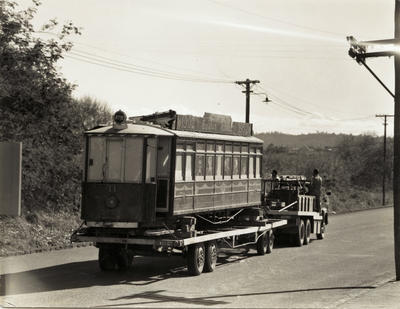 [Tram no. 11 being towed by trailer]