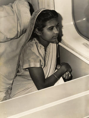 [Young Indian girl in a flying boat]