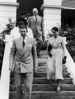 Photograph of John Wisdom and Geoff Roberts with four other people wakling down some steps